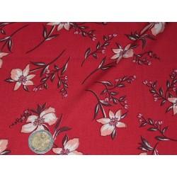 Tissu imprimé fleurs fond rouge